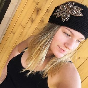 Black knitted head band with embellished flower